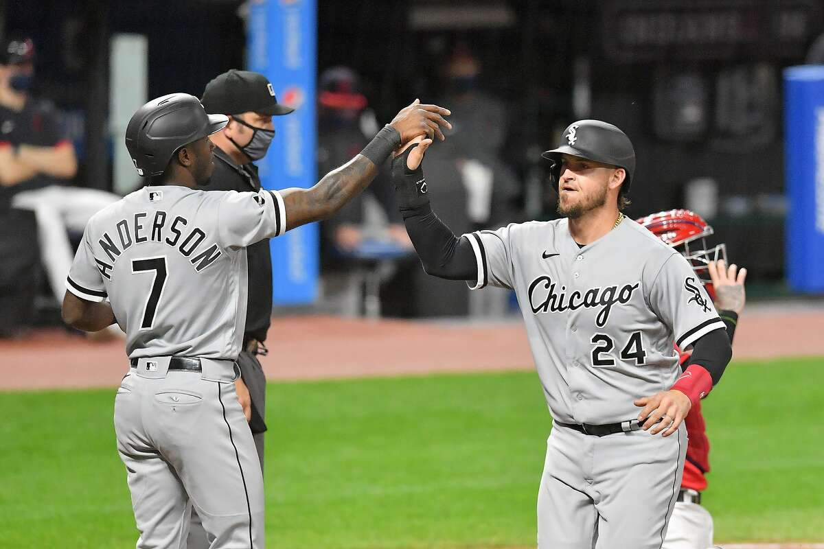 White Sox teammates Tim Anderson, left, and Yasmani Grandal celebrate after both scored on a single by José Abreu during the fifth inning of a Sept. 21 game against Cleveland.