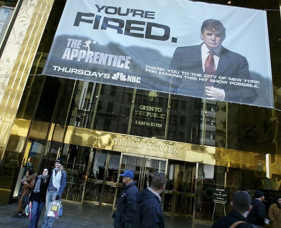 """FILE -- An advertisement for """"The Apprentice"""" hangs on Trump Tower on Fifth Avenue in New York, March 23, 2004. ÒThe Apprentice,Ó along with endorsements and other income that sprang from his growing fame, brought Donald Trump $427.4 million. The New York Times Times obtained Donald TrumpÕs tax information extending over more than two decades, revealing struggling properties, vast write-offs, an audit battle and hundreds of millions in debt coming due. (Richard Perry/The New York Times) Photo: Richard Perry, NYT"""