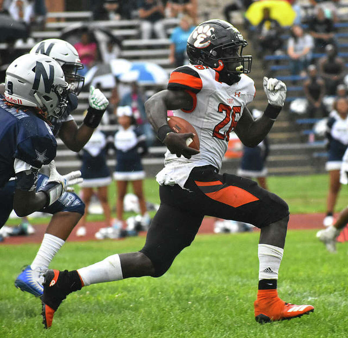 Edwardsville running back Justin Johnson Jr. speeds past the defense on his way to a 30-yard rushing touchdown against McCluer North in the 2019 season opener.