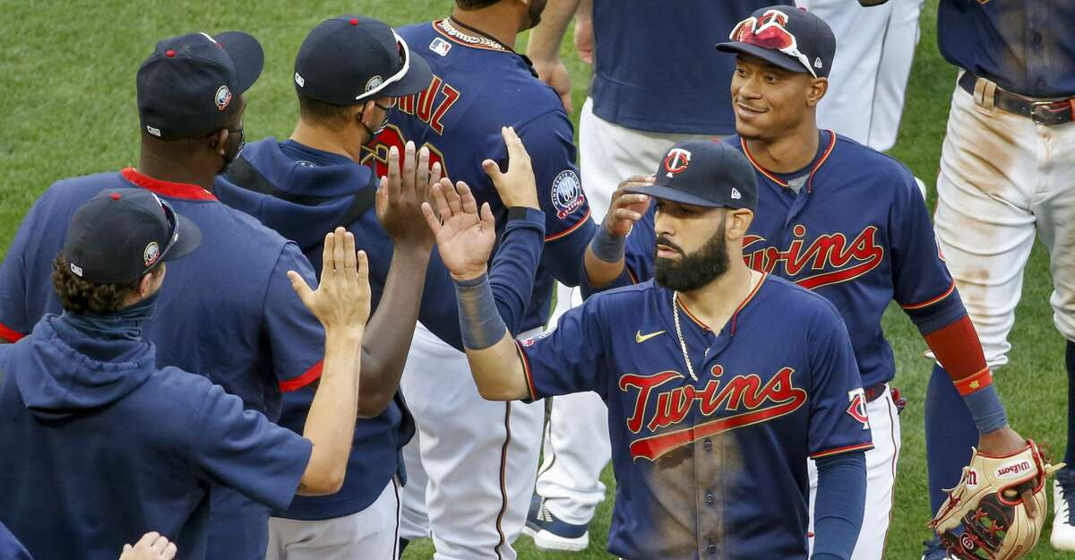 Minnesota Twins' Marwin Gonzalez, front, and Jorge Polanco celebrate with teammates the win over the Detroit Tigers in the second game of a baseball doubleheader Friday, Sept. 4, 2020, in Minneapolis. The Twins won 3-2 in eight innings. (AP Photo/Bruce Kluckhohn)