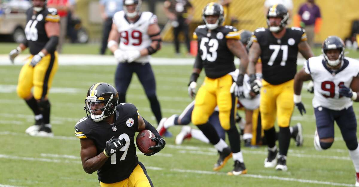 Pittsburgh Steelers wide receiver JuJu Smith-Schuster (19) is wide open as he make a 26-yard touchdown reception against the Houston Texans during the first half of an NFL football game on Sunday, Sept. 27, 2020, at Heinz Field in Pittsburgh.