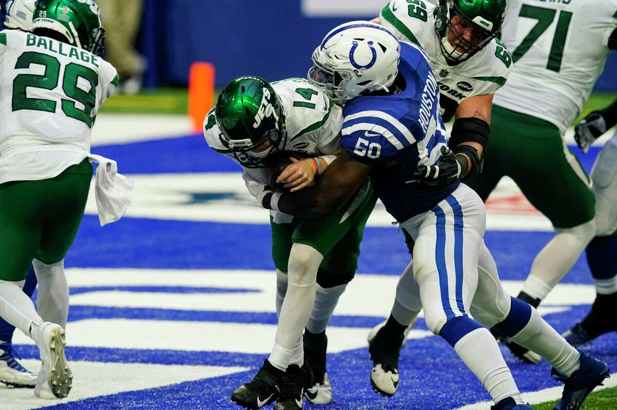 Indianapolis Colts defensive end Justin Houston (50) sacks New York Jets quarterback Sam Darnold (14) for a safety in the second half of an NFL football game in Indianapolis, Sunday, Sept. 27, 2020. (AP Photo/Darron Cummings)