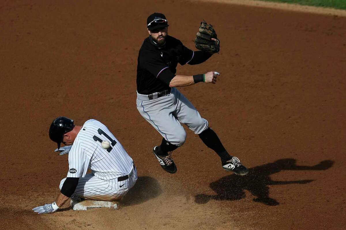 NEW YORK, NEW YORK - SEPTEMBER 27: Jon Berti #5 of the Miami Marlins turns a double play as Brett Gardner #11 of the New York Yankees slides into second during the second inning at Yankee Stadium on September 27, 2020 in the Bronx borough of New York City. (Photo by Sarah Stier/Getty Images)