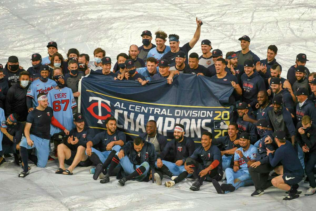 Despite losing their regular-season finale to the Reds on Sunday, the Twins were able to celebrate a second consecutive AL Central title thanks to the White Sox's loss to the Cubs.