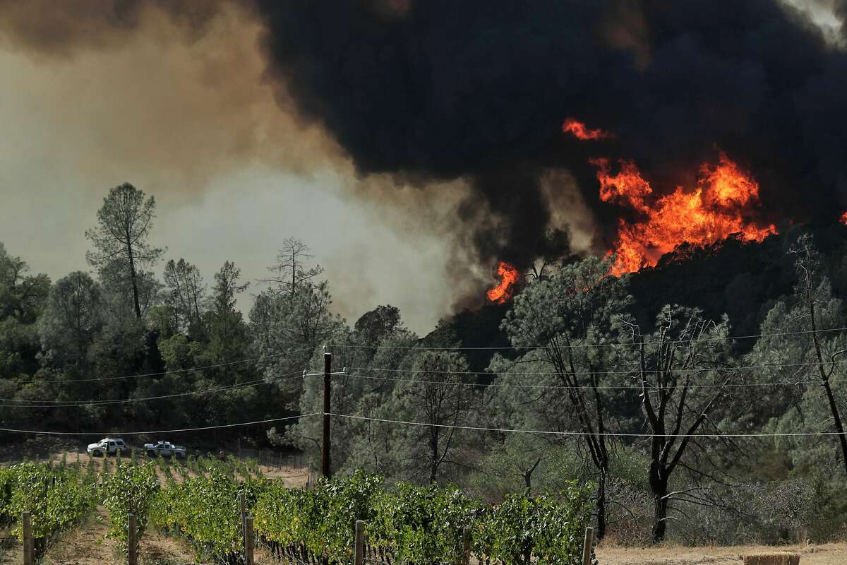 Two CalFire trucks are stationed near Viader Vineyards & Winery above Bell Canyon Reservoir as the Glass fire burned north of St. Helena, Calif., on Sunday, September 27, 2020.