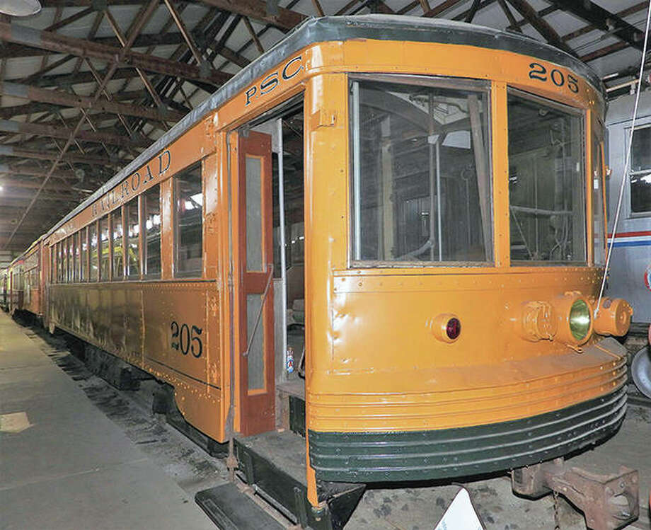 Streetcar 205 sits in preservation inside a cavernous barn, alongside similar early 20th century machines, at the Illinois Railway Museum in the small town of Union, an hour northwest of Chicago. Photo: Mark Bennett | Tribune-Star (AP)
