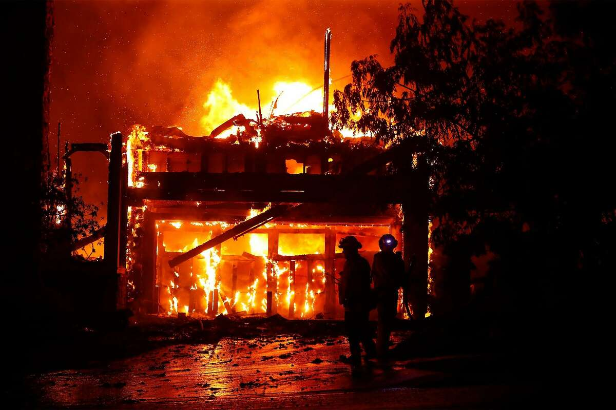Two firefighters stand by a fully engulfed house as the Shady Fire burns in Skyhawk area of Santa Rosa, Calif., on Monday, September 28, 2020.