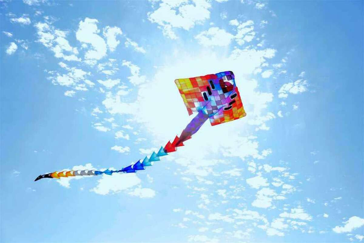 The enormous 50-foot manta ray kite flies high at the ShoreFest on a Roll event at Sherwood Island State Park on Sunday, Sept. 20, 2020, in Westport, Conn.