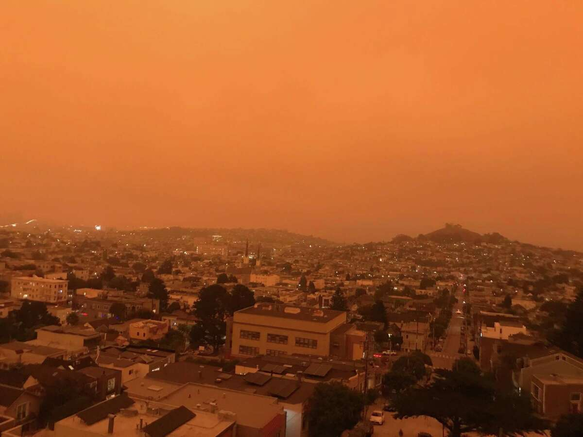 San Francisco is unrecognizeable as seen from Billy Goat Hill Park, bathed in the yellow/orange pallor of wildland fire smoke-choked skies on Wednesday, Sept. 9, 2020. Smoke from multiple wildland fires buring in California and neighboring states is fouling the sky, blotting out the sun.