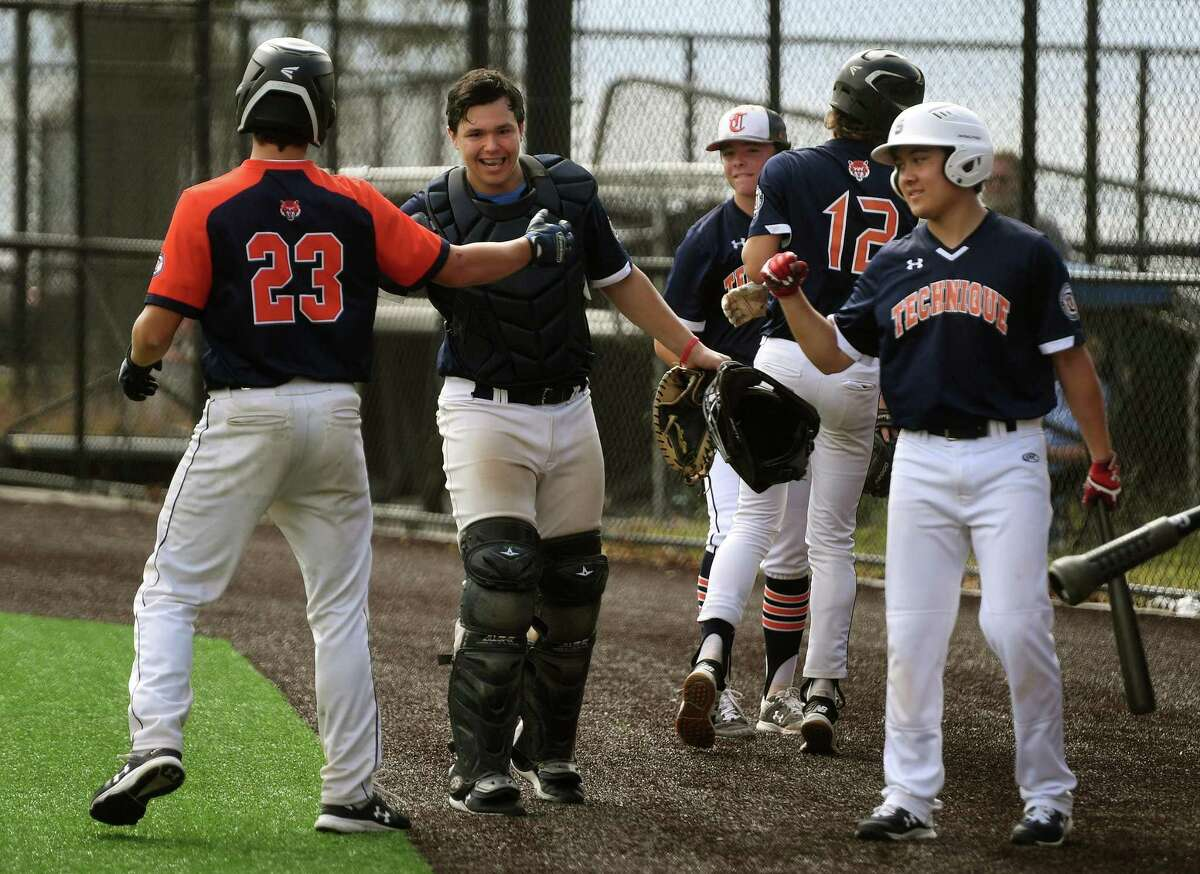 Technique Tigers players celebrate two runs scored during the second annual LivFree charity baseball tournament at Seaside Park in Bridgeport, Conn. on Sunday, September 27, 2020. The organization raises money through athletic tournaments for pediatric cancer patients and their families.