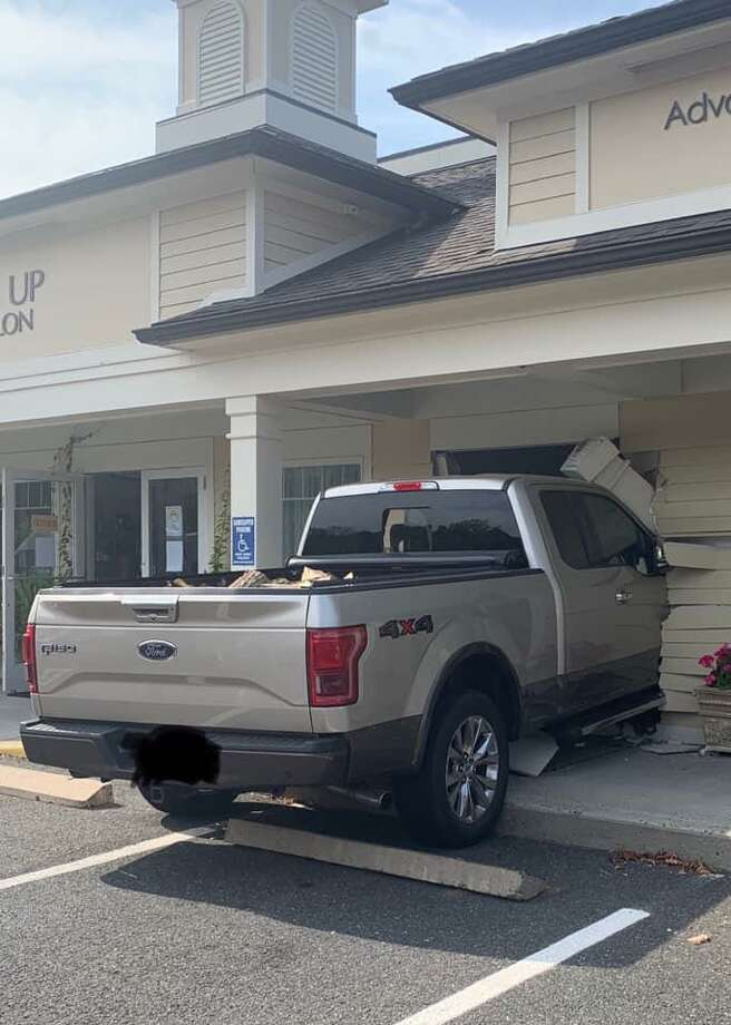 A pickup truck crashed into a building at 760 Main Street South in Southbury, Conn., Sept. 25, 2020. Photo: Southbury Fire Department