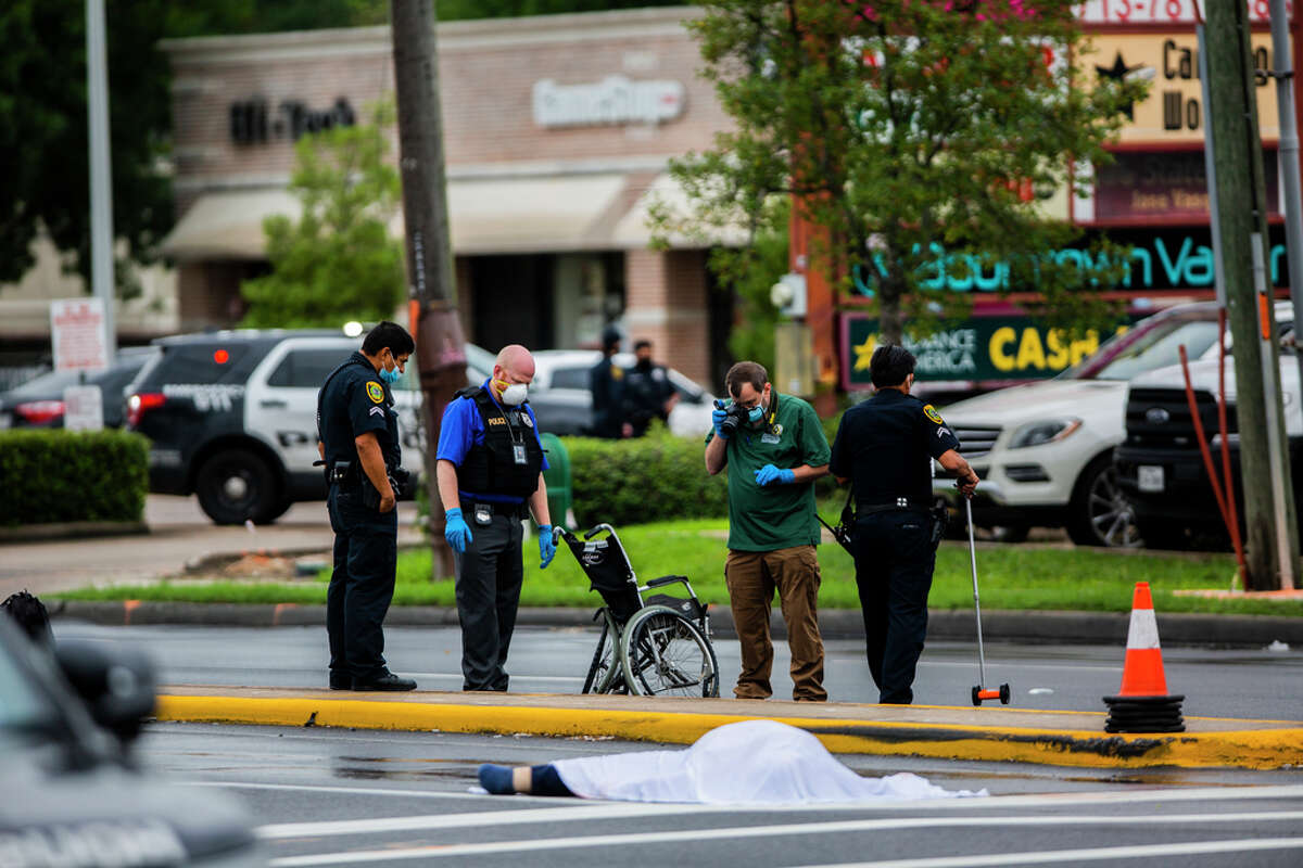 HPD officers work the scene of a fatal crash on the intersection of Dunlave and Westheimer Road Monday, Sept. 28, 2020, in Houston. A woman on a wheelchair died on the scene of the crash.