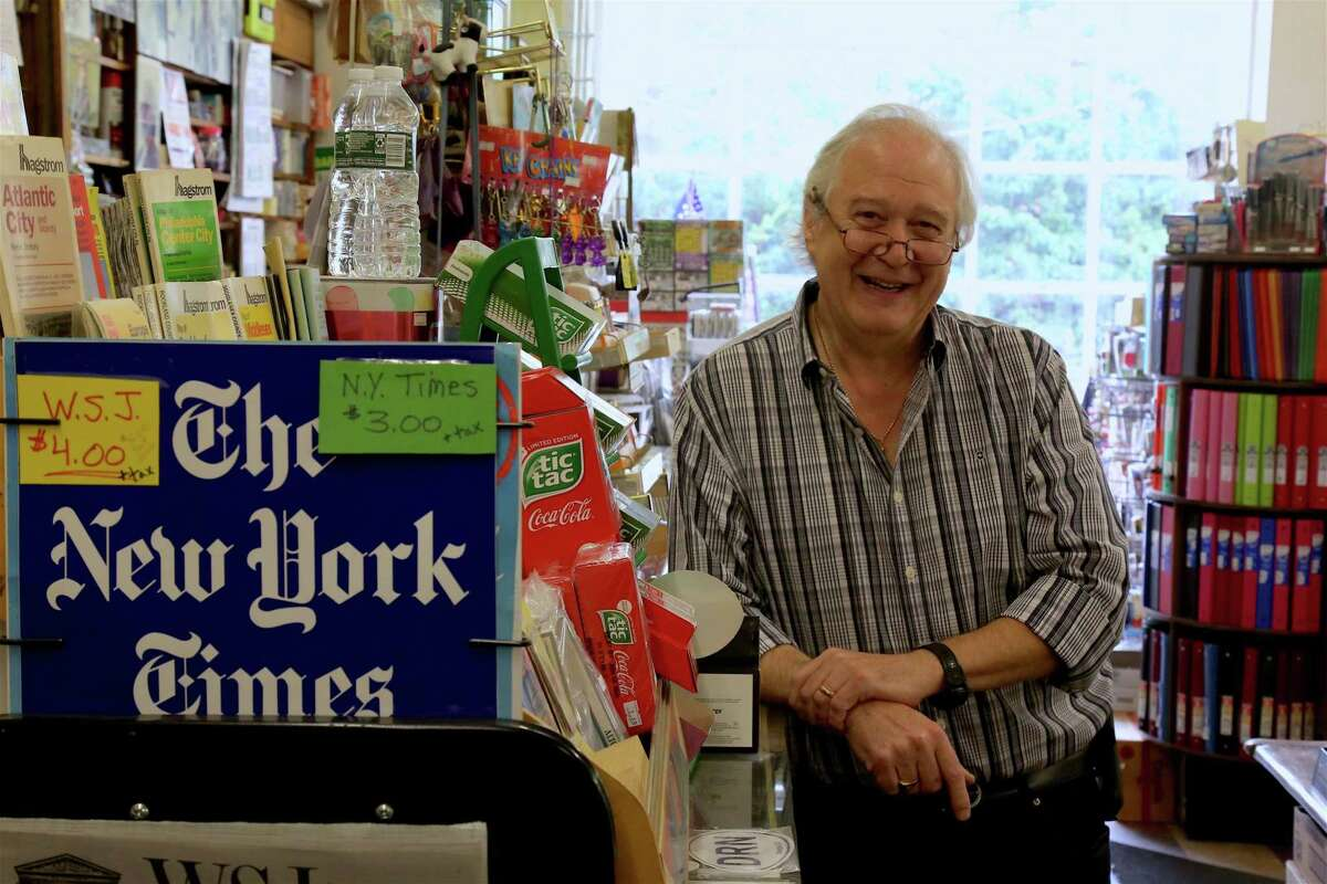 """Darien native Bill Frate at his store on Tokeneke Road. Yet for many residents, none are as significant as the Tokeneke Road store his grandparents opened in 1928. """"I came into the business as soon as I could lift a bundle of newspapers,"""" said Frate, a 1973 graduate of Darien High School. Prior to that, in 1950, Lottie and Gennaro Frate actually built the building in which the store is currently housed, moving the store from its original location just several stores over to the west."""