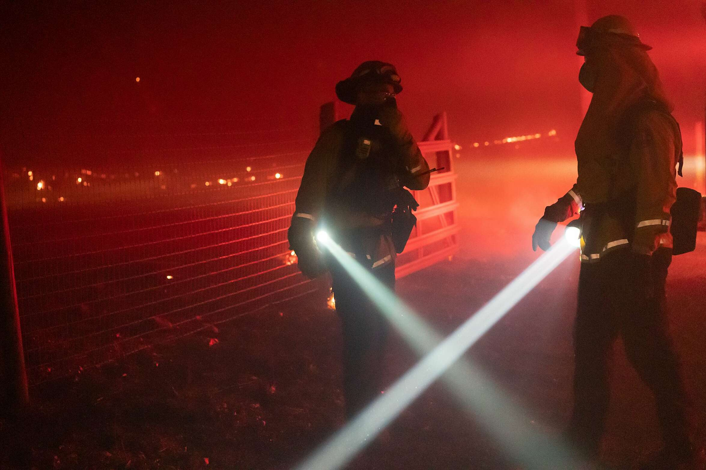 Firefighters discuss the spread of fire towards homes during the Glass on Monday, Sept. 28, 2020 in Santa Rosa, Calif.
