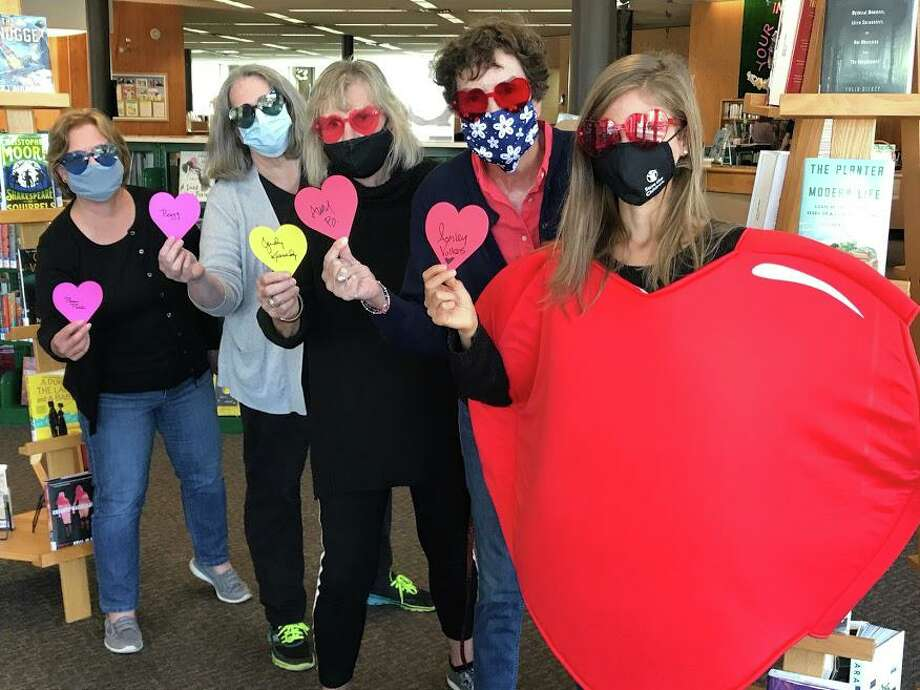 Members of the Friends of the Milford Library leadership hold up their signed hearts: Pam Pilla, Peggy Bolger, Judy Kennedy, Amy Bringardner, and Ashley Volkens. Photo: Friends Of The Milford Library