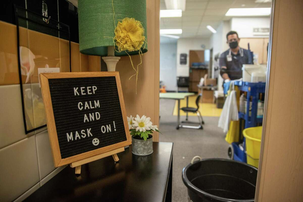 A sign outside a classroom reminds students to wear masks at an elementary school in Leander, Texas, U.S., on Friday, Sept. 18, 2020. On Wednesday, Austin Independent School District's superintendent shared with parents, teachers and staff that she plans to submit a waiver to the Texas Education Agency to request an additional four weeks of virtual learning. Photographer: Sergio Flores/Bloomberg