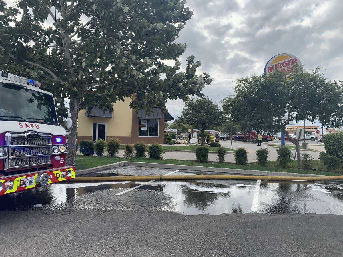 San Antonio firefighters battled to save an East Side Burger King after grease caused the roof of the fast food restaurant to catch fire, according to authorities on the scene.