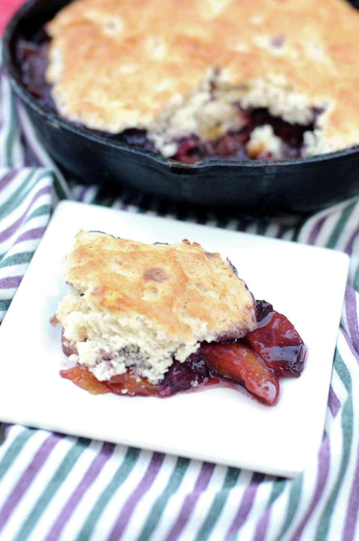 Fire Pit Fruit Cobbler is a classic camp dessert perfect for falll evenings. Recipe, Page E8.