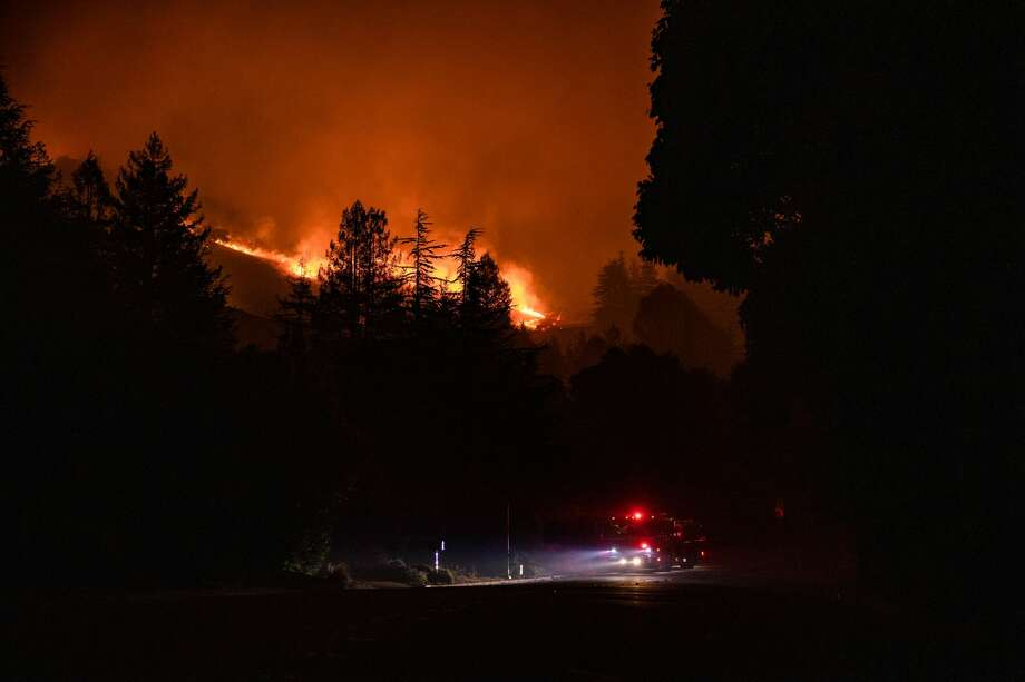 Fire Fighters attempt to fight the Shady Fire as it approaches homes in Santa Rosa, California on September 28, 2020. - The wildfire quickly spread over the mountains and reached Santa Rosa where is has begun to affect homes. Photo: Samuel Corum / Getty