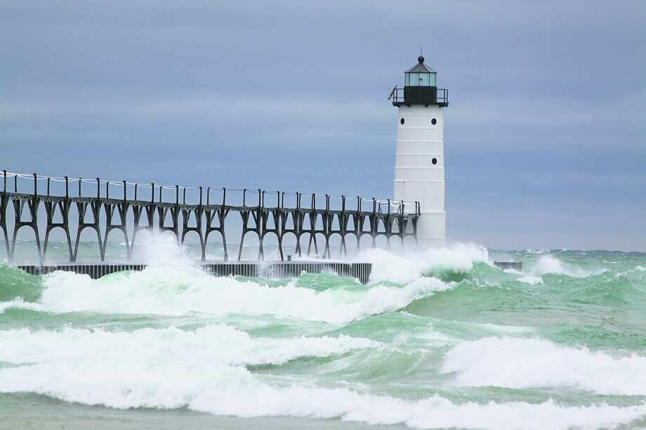 Structures like the Manistee North Pierhead Lighthouse, pictured in December 2018, can attract visitors who don't know how dangerous Lake Michigan can be. Photo: File Photo
