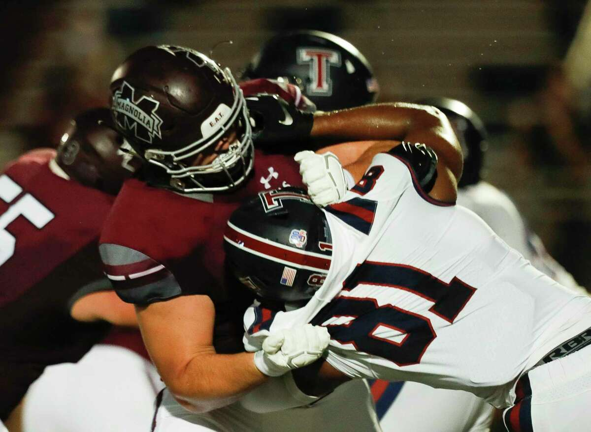 Magnolia offensive linemen Matthew Wykoff (74) goes up against Katy Tompkins defensive linemen Sean Dubose (81) during the second quarter of a non-district high school football game at Bulldog Stadium, Friday, Sept. 25, 2020, in Magnolia.