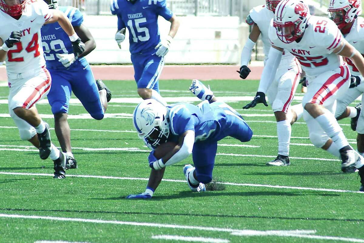 Clear Springs' Kaleb Hymes (22) fights for yardage against Katy Saturday at Challenger Columbia Stadium.