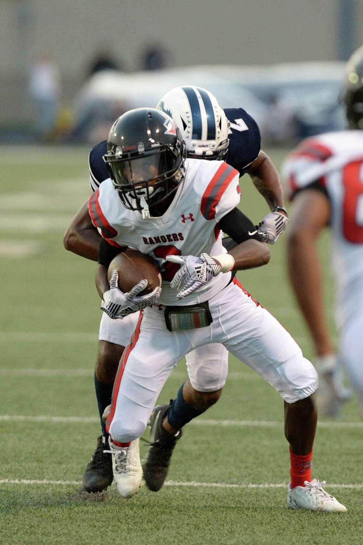 Sergio Simmons (3) of Terry carries the ball during the first quarter of a high school football game between the Lamar Consolidated Mustangs and the Terry Rangers on Friday, September 13, 2019 at Traylor Stadium, Rosenberg, TX.