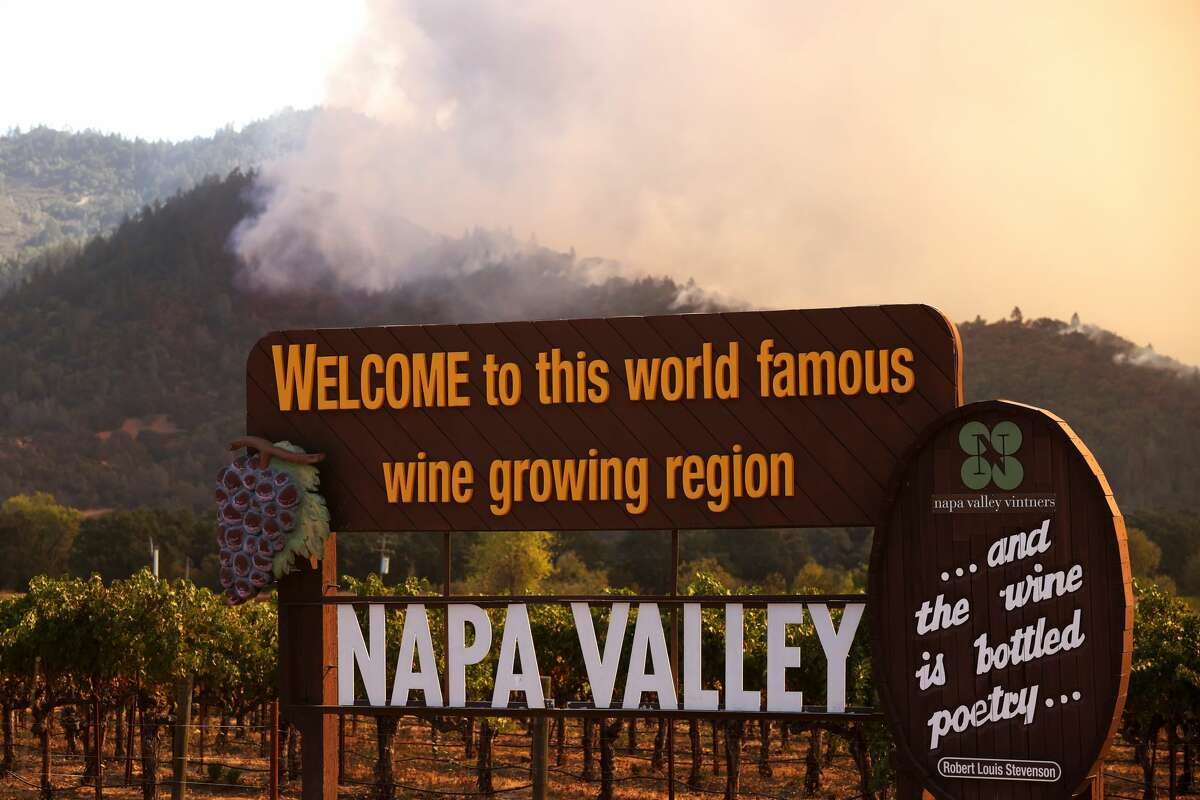 Smoke from the Glass Fire rises from the hills on Sept. 27, 2020, in Calistoga, Calif. Smoke from fires in the North Bay are projected to swirl around the Bay Area this week.