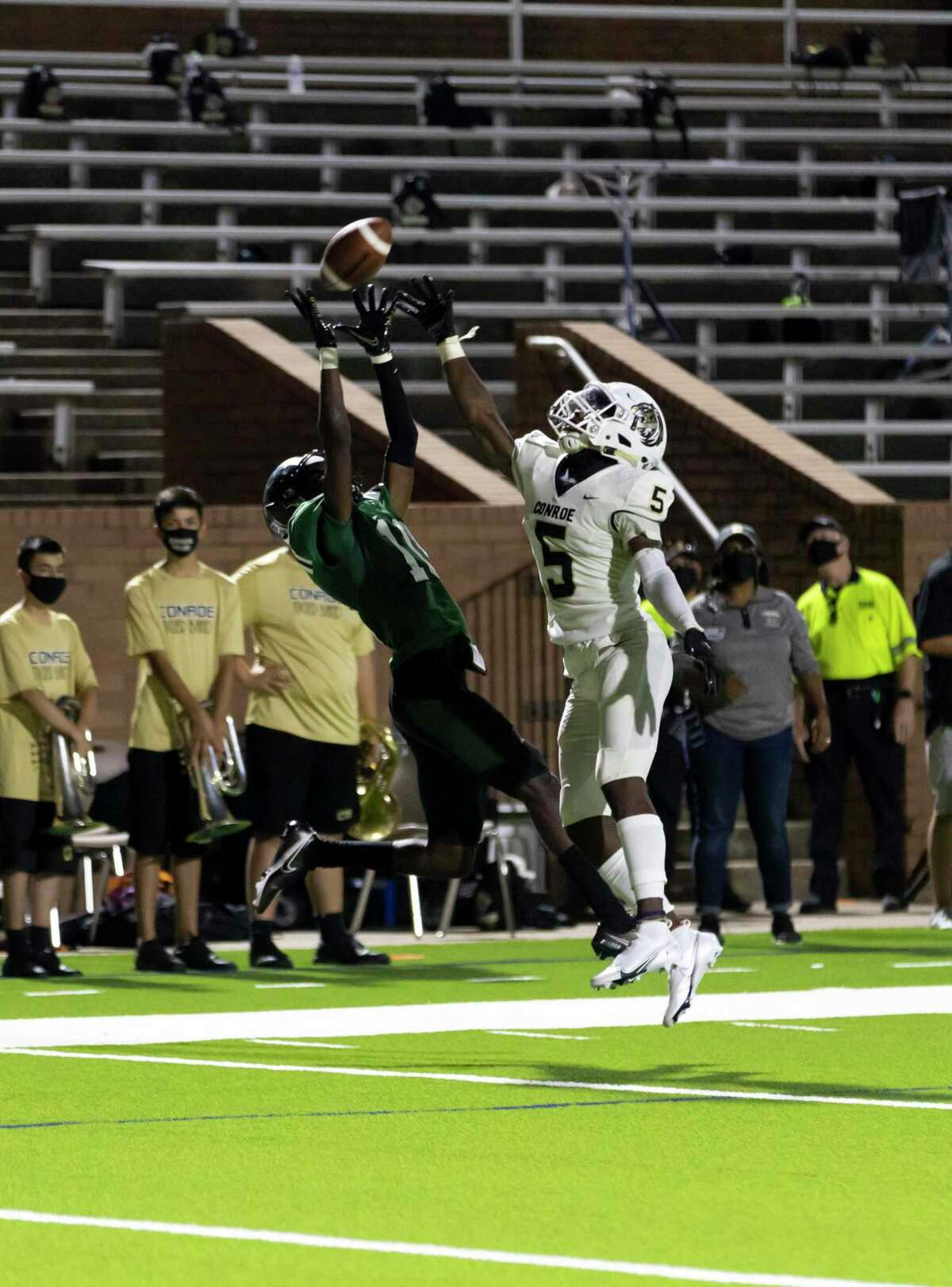 Mayde Creek defensive back Alpha Khan (10) catches a pass while under pressure from Conroe defensive back Zayden Kimple (5) during the second quarter of a non-district football game at Rhodes Stadium in Katy, Friday, Sept. 25, 2020.