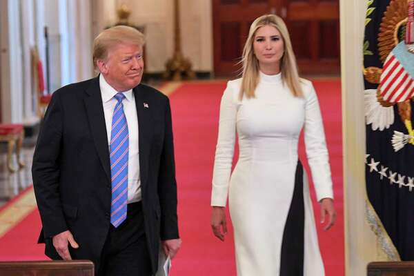 President Donald Trump walks with his daughter, Ivanka Trump, a White House adviser.