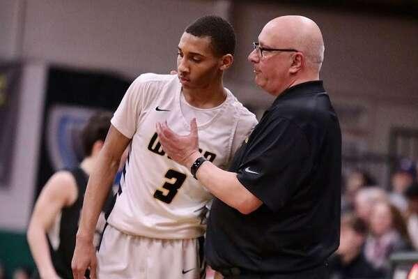 UCon commit Rahsool Diggins, left, and Archbishop Wood High coach John Mosco during a game last season.