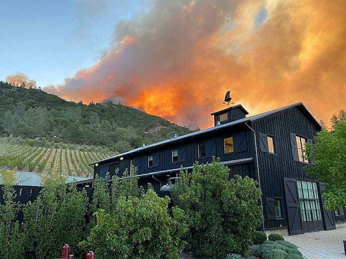 The Glass Fire is seen in the hills above Davis Estates winery in Calistoga on Sept. 27, 2020.