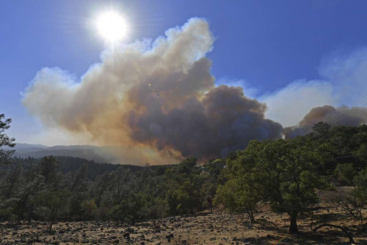 Smoke from the Glass Fire reaches high into the sky in St. Helena, Calif., on Sunday, Sept. 27, 2020.