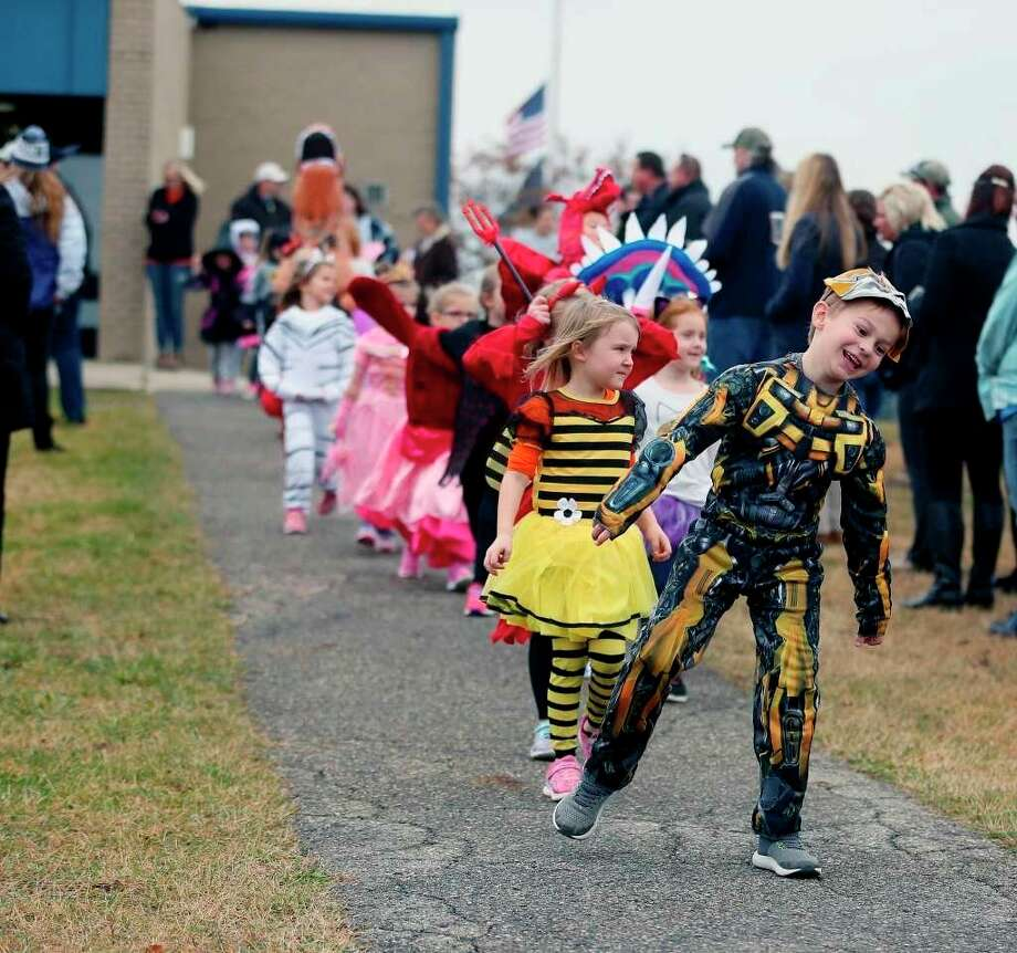 Bad Axe Elementary students participate in a Halloween parade in 2018. The MDHHS put out recommendations for people to follow on Halloween this year, including having parades similar to this to help ensure social distancing. (Tribune File Photo)