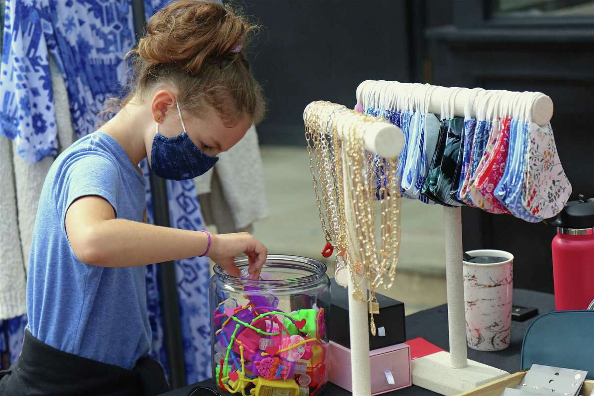 Hannah Rowley, 8, of Westport does some shopping at the Fall Fashion & Beauty Day downtown on Saturday, Sept. 26, 2020, in Westport, Conn.