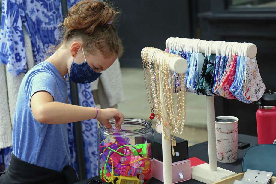 Hannah Rowley, 8, of Westport does some shopping at the Fall Fashion & Beauty Day downtown on Saturday, Sept. 26, 2020, in Westport, Conn. Photo: Jarret Liotta / For Hearst Connecticut Media / Jarret Liotta / ©Jarret Liotta 2020