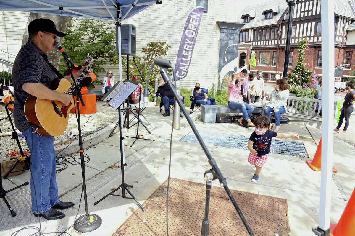 Bill Nollman of Norwalk performs in Needle Park on Main Street at the Fall Fashion & Beauty Day downtown on Saturday, Sept. 26, 2020, in Westport, Conn.