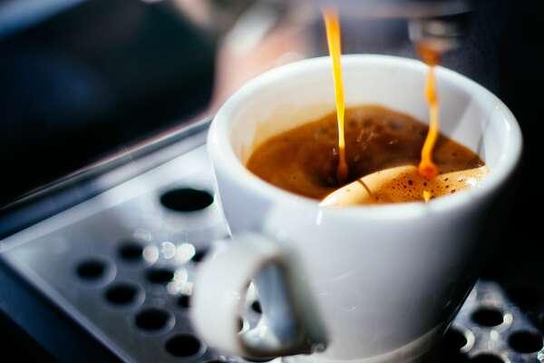 Espresso shot pouring out of a espresso machine.