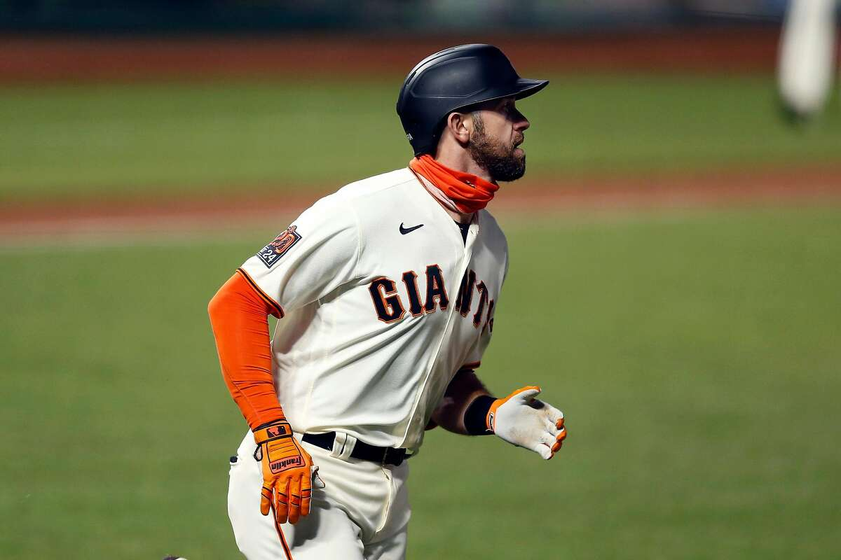 Evan Longoria of the San Francisco Giants rounds the bases after hitting a solo home run in the bottom of the fourth inning against the Colorado Rockies last Wednesday.