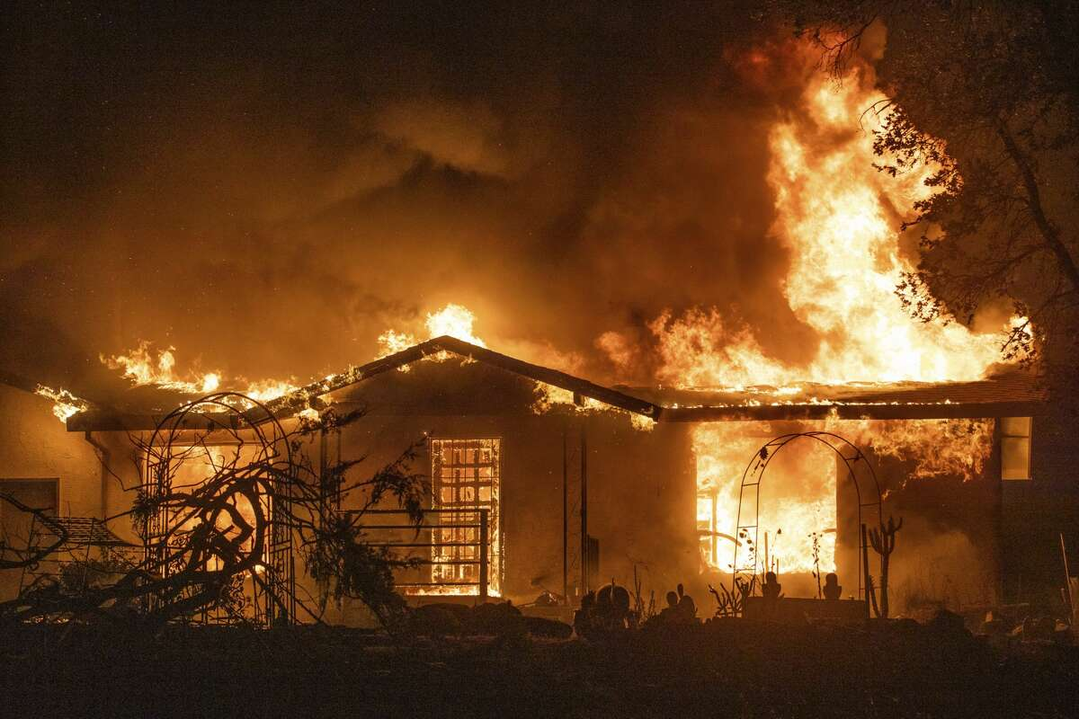 A house burns on Platina Road at the Zogg Fire near Ono, Calif., on Sunday, Sep. 27, 2020.