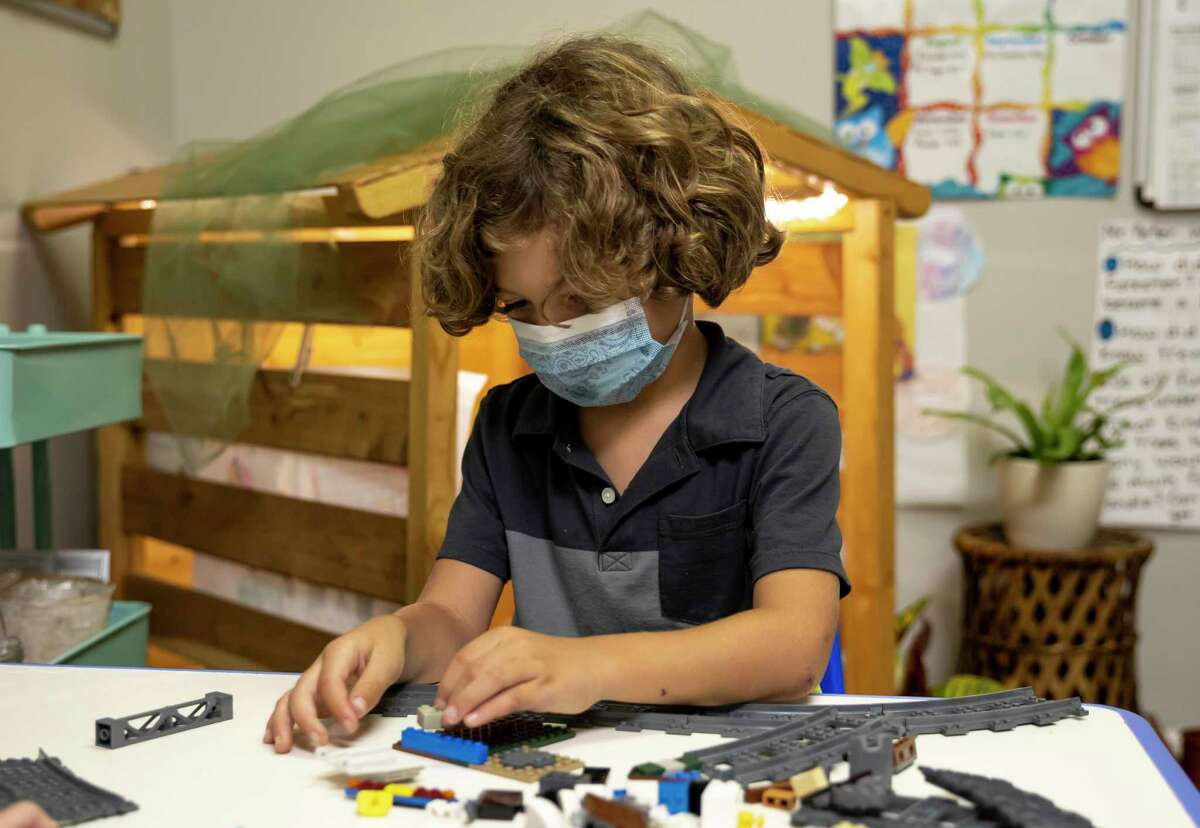 Enzo plays with a variety of building blocks at the Discovery School of Innovation in The Woodlands, Thursday, Sept. 24, 2020. The new school opened this year and plans to expand enrollment in the future.