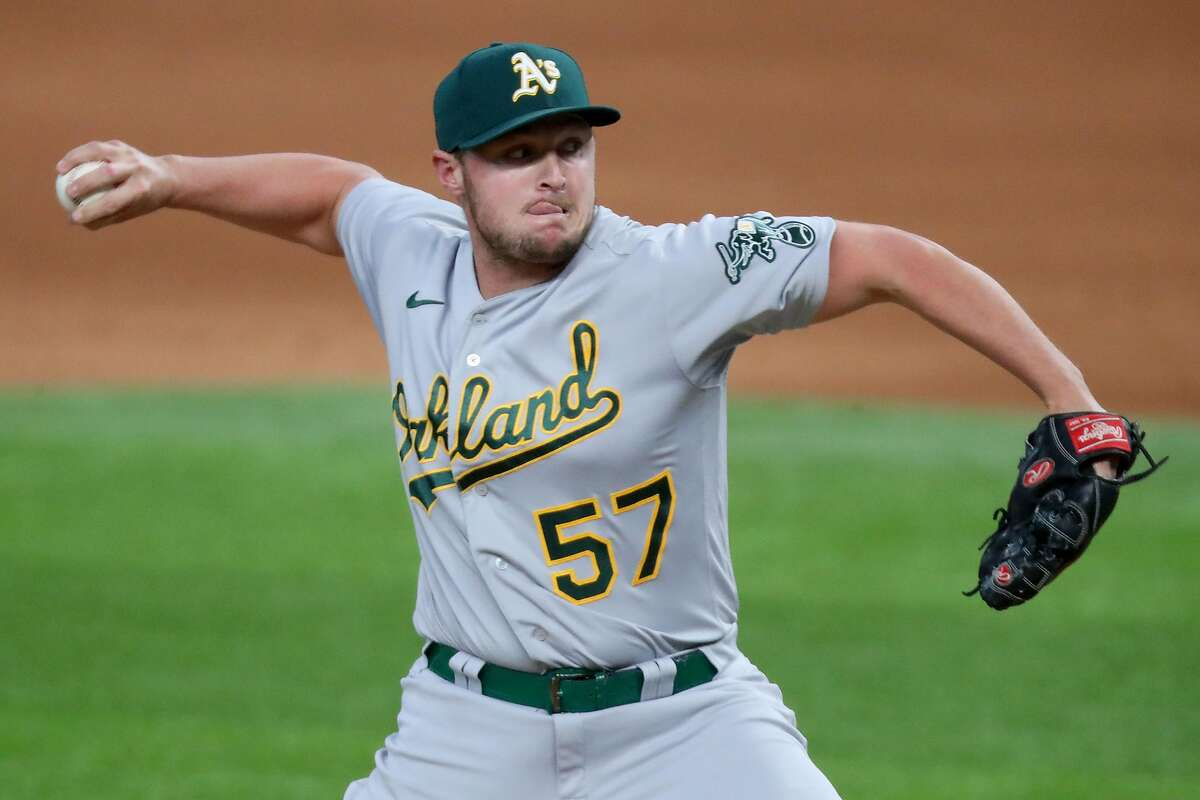ARLINGTON, TEXAS - SEPTEMBER 13: J.B. Wendelken #57 of the Oakland Athletics pitches against the Texas Rangers in the bottom of the eighth inning at Globe Life Field on September 13, 2020 in Arlington, Texas. (Photo by Tom Pennington/Getty Images)