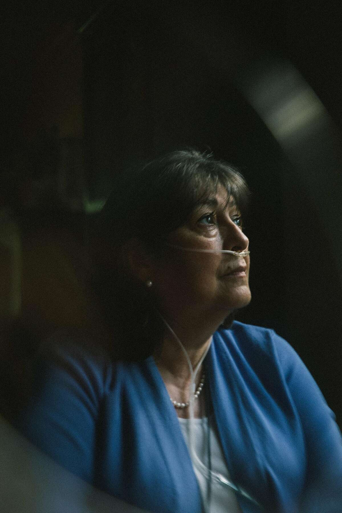 Manuella Fehertoi, who has been unable to work her banking job and now needs oxygen around the clock, at her home in Middletown, N.J., Sept. 1, 2020. With 7 million known cases of the coronavirus across the country, more people are suffering from symptoms that go on and on. (Celeste Sloman/The New York Times)