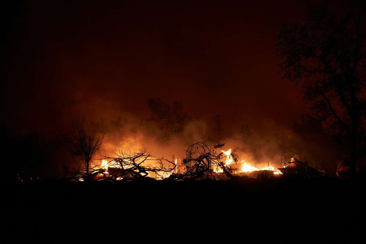 The fire burns a home along Platina Road in Igo, on September 27, 2020.
