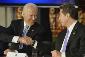 Vice President Joseph Biden, left, shakes hands with Governor Andrew Cuomo at the Capitol in 2014. If Biden wins the presidency, might he tap Cuomo for a role in his administration? (File photo)
