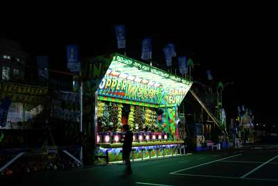 Only a few lights were turned on in the evening at the carnival area of the Houston Livestock Show and Rodeo on Wednesday, March 11, 2020.
