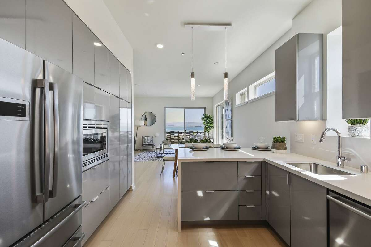 Each of the 56 single-family homes at the Palisades in the Shipyard San Francisco feature an open floor plan and kitchen equipped with stainless steel appliances.