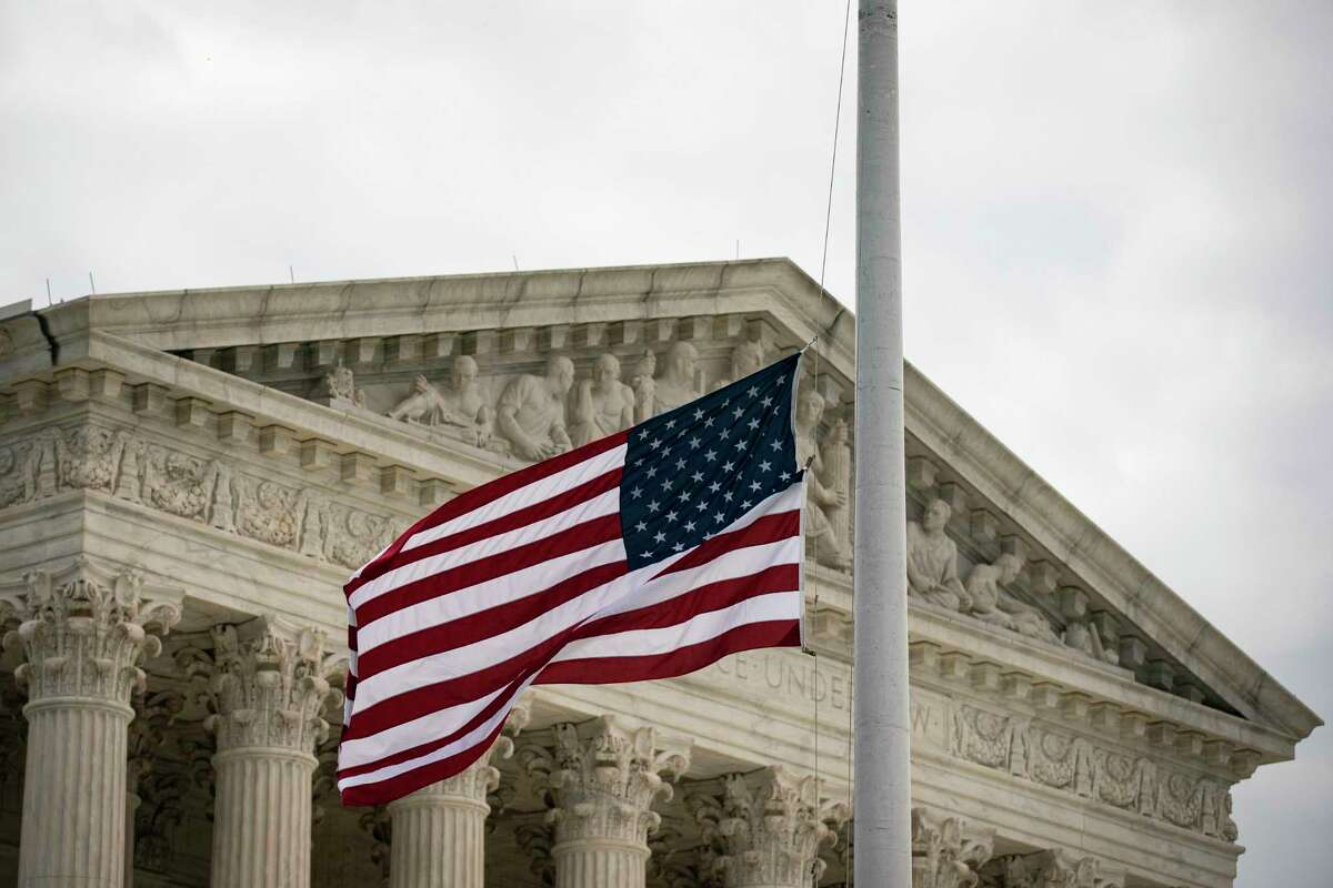 WASHINGTON, DC - SEPTEMBER 28: The American flag flies at half staff following the passing of Supreme Court Associate Justice Ruth Bader Ginsburg, at the U.S. Supreme Court on September 28, 2020 in Washington, DC. This week Seventh U.S. Circuit Court Judge Amy Coney Barrett, U.S. President Donald Trump's nominee to the Supreme Court, will begin meeting with Senators as she seeks to be confirmed before the presidential election. (Photo by Al Drago/Getty Images)