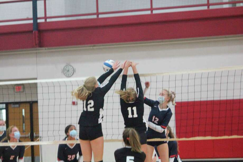 Big Rapids' Jenna Williams plays the ball at the net in recent volleyball action. (Pioneer photo/John Raffel)