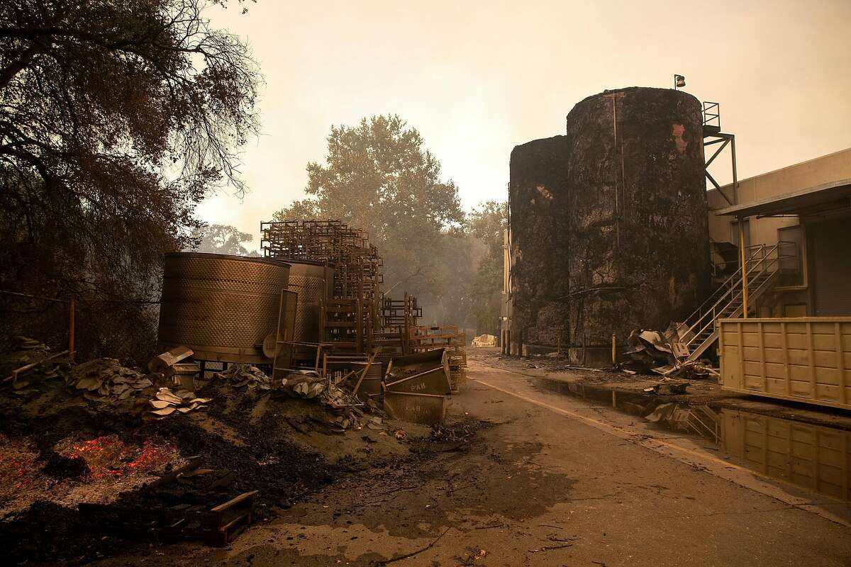 Fermentation tanks are burned behind the shipping and receiving building during the Glass Fire at Sterling Vineyards in Calistoga, Calif. on Monday morning, Sept. 28, 2020.